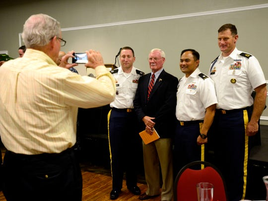 Col. Edward Hubbard, U.S. Air Force retired, is photographed with Cpt. Patrick Lamonda, left, Lt. Col. Henry Delacruz and Mst. Sgt. Roy Clark, right, on Friday after giving a talk Friday at the Panhandle Tiger Bay Club luncheon at New World Landing. Hubbard spent 2,420 days as a prisoner of war in North Vietnam.