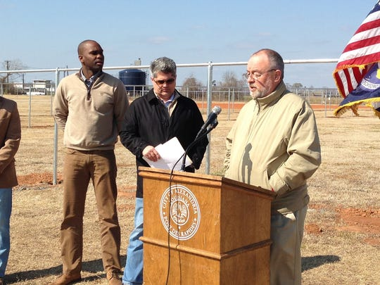 Alexandria City Council President Chuck Fowler (right) talks Friday about the new practice fields for baseball and softball at Johnny Downs Sports Complex. Fencing to complete the fields will be done soon. Listening are (from left) Parks and Recreation Superintendent Cam Hallman, Community Services Director Daniel Williams and Mayor Jacques Roy.