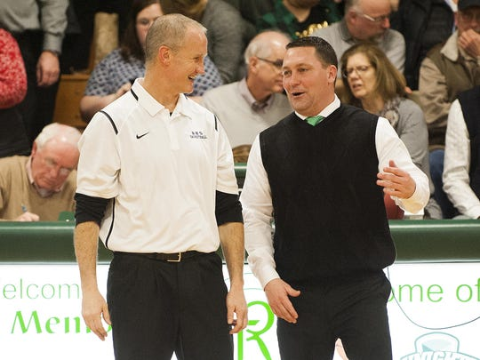 Burlington head coach Matt Johnson (left) and Rice head coach Paul Pecor talk to each other prior to the boys basketball game between the Burlington Seahorses and the Rice Green knights at Rice Memorial High School on Jan. 7, 2016 in South Burlington.