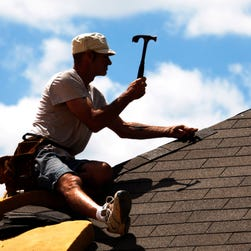 This guy is putting shingles on. In New Mexico, they got ripped off. As in stolen.