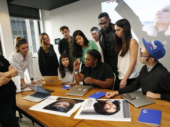 Members of the Droga5 group behind the recent CoverGirl campaign talk about that campaign during a meeting at the advertising agency's headquarters, Tuesday, Oct. 24, 2017, in New York. Creative director Ray Smiling, third from right, listens with other team members as fellow creative director Shannon Washington, seated at center, makes her point to the group. Diversity in the advertising industry is becoming a higher priority for consumer product companies as they try to reach a new generation of customers with evolving sensibilities on ethnicity, age, gender and sexuality. (AP Photo/Kathy Willens)