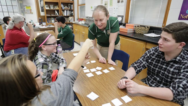 Golden Apple winner Renee Stein, a math and special education teacher at Ashwaubenon High School, works with a group taking pre-algebra March 23, 2017.