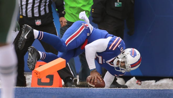 Bills quarterback Tyrod Taylor dives into the end zone for a 18 yard touchdown run in a 22-17 win over the Jets.  The win spoiled the playoff chances for the Jets.