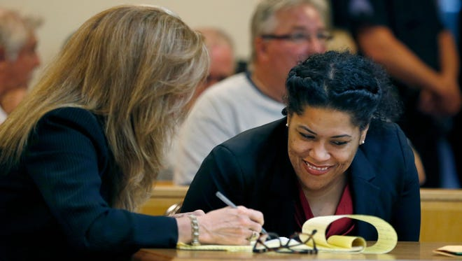 Judge Leticia Astacio of Rochester (N.Y.) City Court appears Aug. 3, 2017, before Judge Stephen Aronson of Canandaigua City Court with defense lawyers Bridget Field, left, and Mark Young. She is accused of violating probation for a jail term that began with a drunken-driving offense.