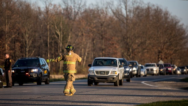 Members of the Clyde Township Fire and St. Clair County Sheriff's departments investigate the scene of an accident between a truck and a motorcycle Thursday, Nov. 17, 2016 at Beard and Wildcat roads in Clyde Township.