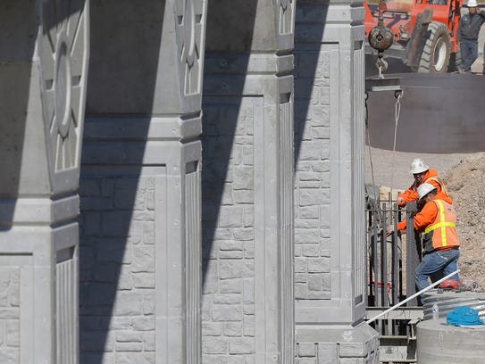 Workers prepare for concrete as they work on the Border