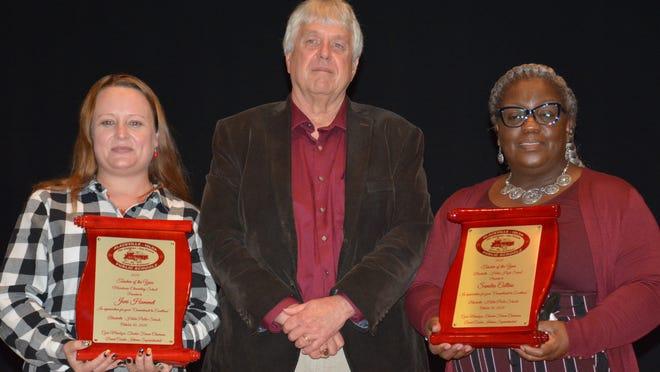 D19 Superintendent David Corder congratulates MEMS Teacher of Year Joni Hammet and D19 Teacher of the Year Sandra Collins on Oct. 30.