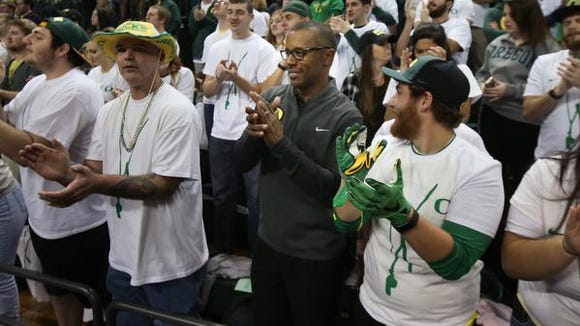 Oregon's new head football coach Willie Taggart, center right, joins the student section at Matthew Knight Arena for part of the first half of the Alabama vs. Oregon men's NCAA college basketball game Sunday, Dec. 11, 2016, in Eugene, Ore. (AP Photo/Chris Pietsch)