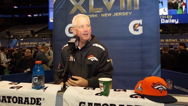 Denver Broncos head coach John Fox is interviewed during Super Bowl XLVIII at Prudential Center.