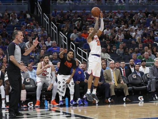 New York Knicks guard Trey Burke (23) shoots a three