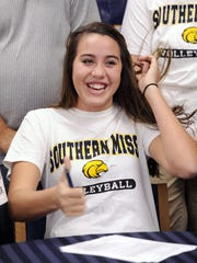 11-11-10, 6c  Gulf Breeze High School senior Jasmine Crowell, 17, signs a NCAA Division I scholarship to play volleyball at Southern Miss next year.