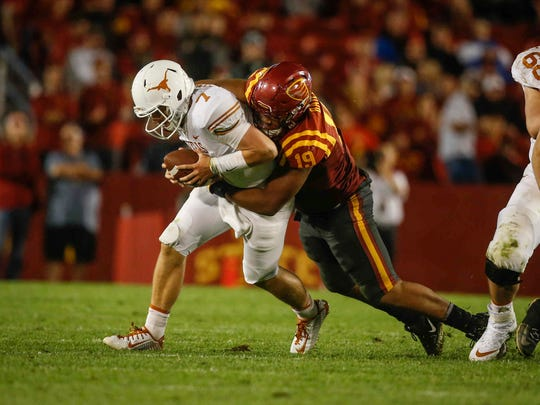 Iowa State defensive end JaQuan Bailey hits Texas quarterback Shane Buechele for a loss of yards on Thursday, Sept. 28, 2017, at Jack Trice Stadium in Ames.