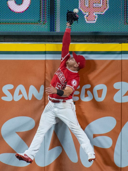 Los Angeles Angels right fielder Kole Calhoun can't catch a solo home run by Oakland Athletics' Matt Olson during the seventh inning of a baseball game Friday, April 6, 2018, in Anaheim, Calif. (AP Photo/Kyusung Gong)
