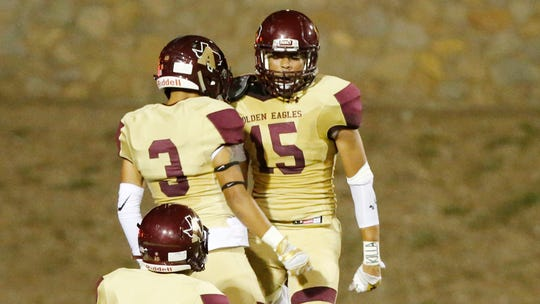 Andress Eagles wide receiver Tre Maestas celebrates