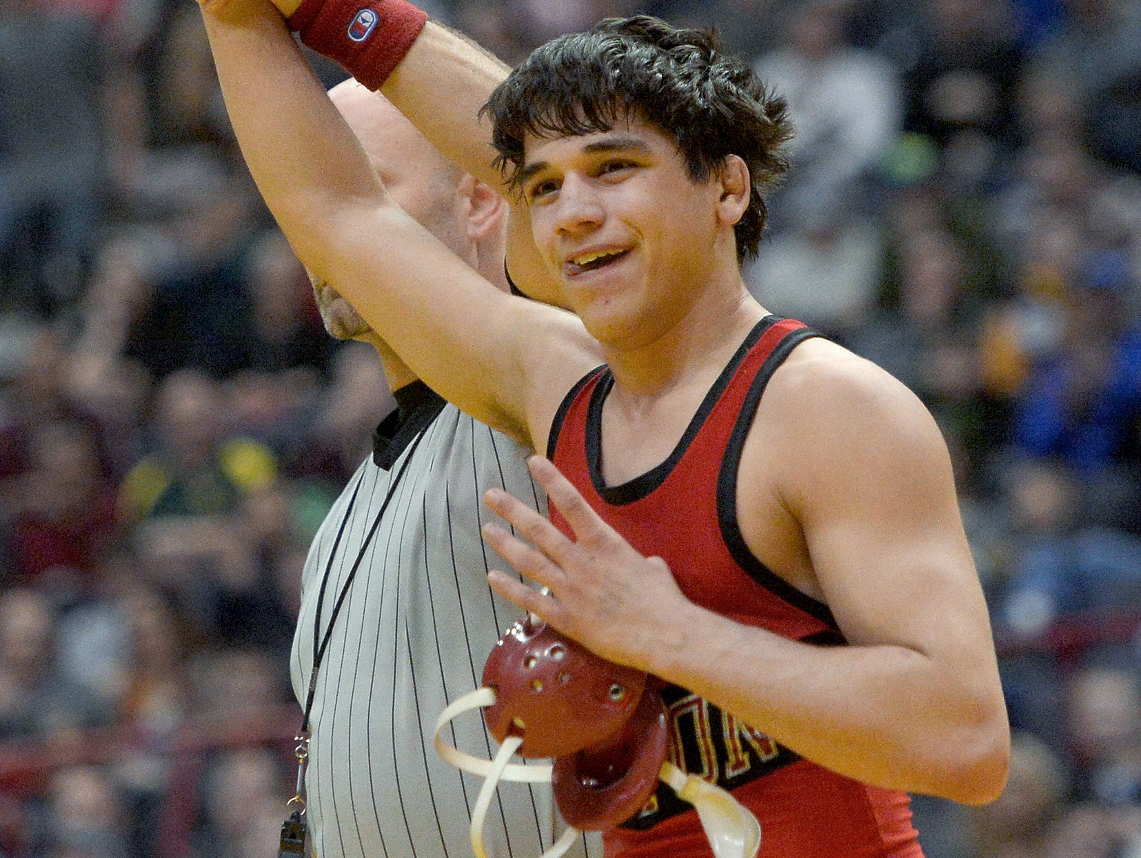 Hilton's Yianni Diakomihalis celebrates his fourth state title after winning the finals of the 138-pound class (Division I) during the NYSPHSAA 2016 State Wrestling Championships held at the Times Union Center in Albany, N.Y. on Saturday, Feb. 27, 2016.