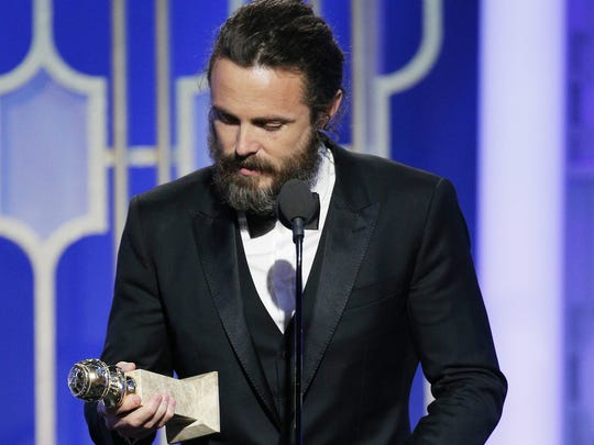 Casey Affleck accepts the award for best actor in a movie drama for 'Manchester by the Sea.'