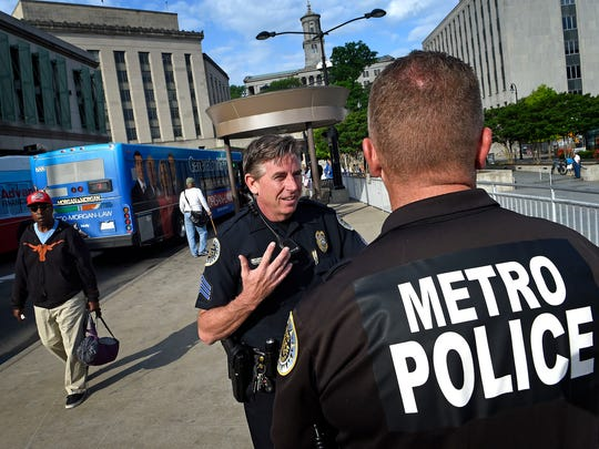 Sgt. Larry Hansen talks with Officer Mike Evans on Tuesday at the Music City Central bus station, where a shooting injured four teenagers Monday.