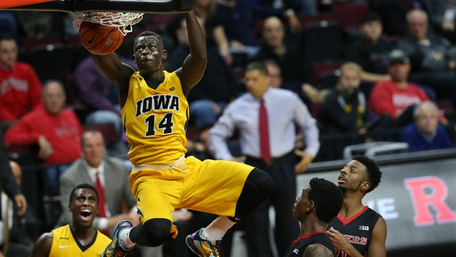 Iowa guard Peter Jok (14) dunks a basket during the first half of an NCAA college basketball game against Rutgers, Thursday, Jan. 21, 2016, in Piscataway, N.J.