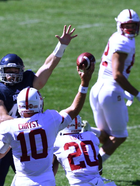 Stanford's quarterback Keller Chryst, front, passes over the Rice defence to teammate Kaden Smith, right, during the opening game of the U.S. college football season in Sydney, Sunday, Aug. 27, 2017. (AP Photo/Michelle O'Connor)