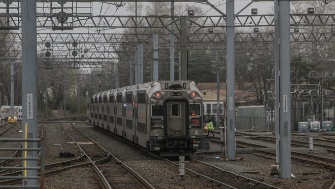 A NJ Transit train approaches the Long Branch station.
