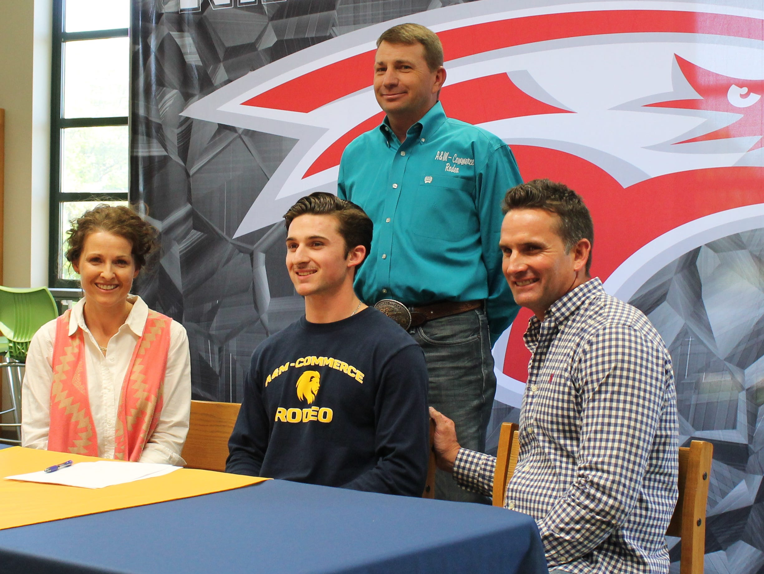 Nixa senior Gavin Michel (front, center) signed a letter of intent to join the rodeo team at Texas A&M University-Commerce at a ceremony May 4, 2016 at Nixa High School.