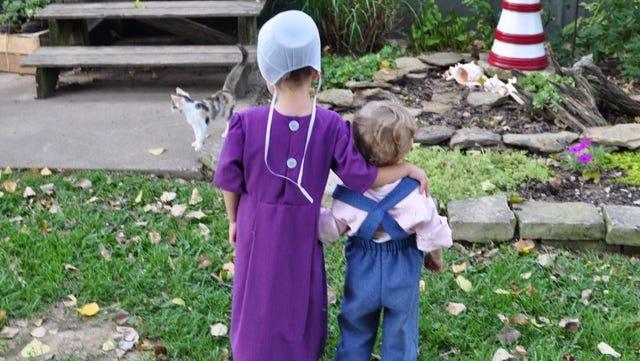 Gloria's children, Julia, 4, and, Austin, 1, enjoy a pleasant day outdoors in Flat Rock.