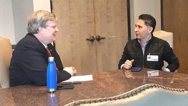Manuel Duran, right, talks with Memphis Mayor Jim Strickland in this undated photo provided by supporters.