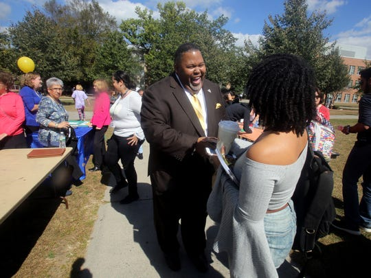 Michael Baston, Rockland Community College's new president, greets student Tamara Russell, 18, at an event on campus Oct. 3, 2017.
