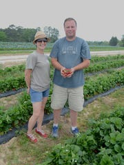 Andrea Snyder, chef at Urban Cookhouse, with Trent Boyd of Harvest Farm.