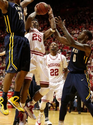 Indiana forward Emmitt Holt (25) tries to put up a shot in traffic during a NCAA men's basketball game on Friday, Nov. 28, 2014, at Assembly Hall in Bloomington. (James Brosher / For The Star)