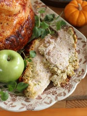 FILE - This Sept. 28, 2015, file photo shows Italian-style roast turkey breast in Concord, N.H. If you're not feeding a crowd for the holidays, then roasting a turkey breast could be the way to go. This dish is from a recipe by Sara Moulton.