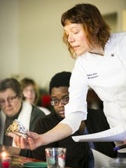 Vermont baker Heike Meyer talks to students during