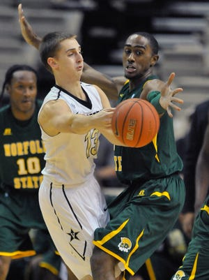 Vanderbilt guard Riley LaChance (13) passes against Norfolk State guard D'Shon Taylor (4) in the first half Tuesday.