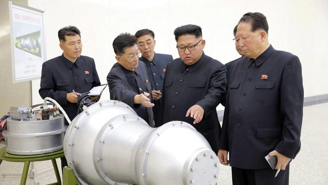 North Korean leader Kim Jong Un, second from right, at an undisclosed location in North Korea. As North Korea steps up its nuclear weapons tests and threats, South Korea's Unification Ministry faces an almost existential crisis.
