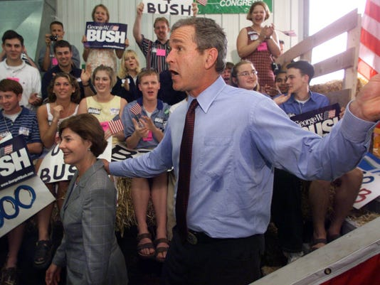 GEORGE W. BUSH STARTS TO WORK CROWD AT AMANA STOP