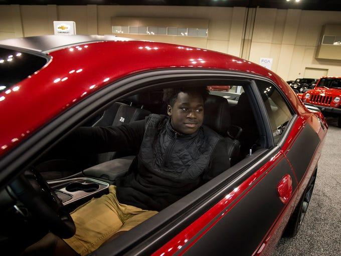 October 27, 2017 - Jadarius Hines, 16, sits in a Dodge