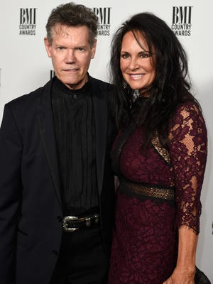 Randy Travis and his wife, Mary, on the red carpet before the BMI Music Awards on Nov. 1, 2016, in Nashville