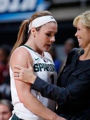 Michigan State coach Suzy Merchant, right, congratulates