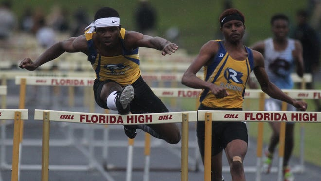 Rickards' Jabari Bryant races to a win in the 110-meter high hurdles during the District 2-2A meet.