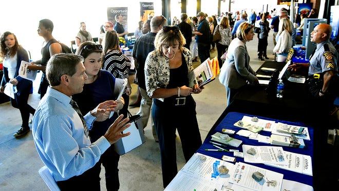 Job seekers meet with recruiters during the York Career Fair last year at Santander Stadium in York City.