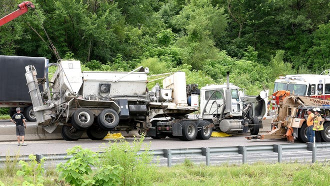 Missouri Highway Patrol and Columbia police investigate a one-vehicle accident on Interstate 70 on Wednesday. A westbound semitruck came upon slowed traffic and hit the median barrier before straddling the barrier. The driver was transported to a Columbia hospital. No other vehicles were involved. One lane in each direction was blocked for several hours.