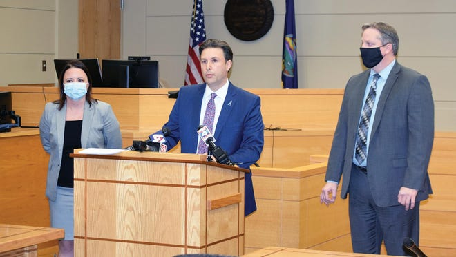 County Attorney Todd Thompson, center, speaks during a news conference Tuesday at the Justice Center in Leavenworth. Thompson announced that a capital murder charge has been filed against Donald R. Jackson Jr. Also pictured are Assistant County Attorneys Megan Williams and Shawn Boyd.