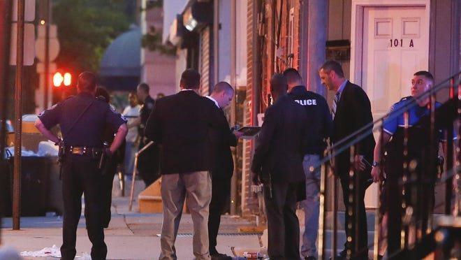 Wilmington police investigate at the scene of a shooting at Lancaster Avenue and Dupont Street Thursday, reported about 8:30 p.m.