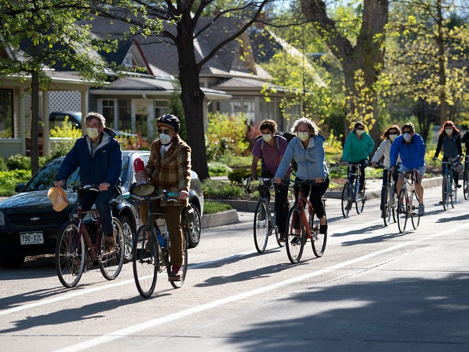 """Bicyclists ride from City Park to the Lincoln Center for a """"listening session"""" with officials from the Colorado Department of Public Health and Environment as part of a protest criticizing the Martin Marietta Materials asphalt plant emissions in Fort Collins Wednesday, May 14, 2014. The meeting was sponsored by the city and the group Citizens Against Asphalt Toxins."""