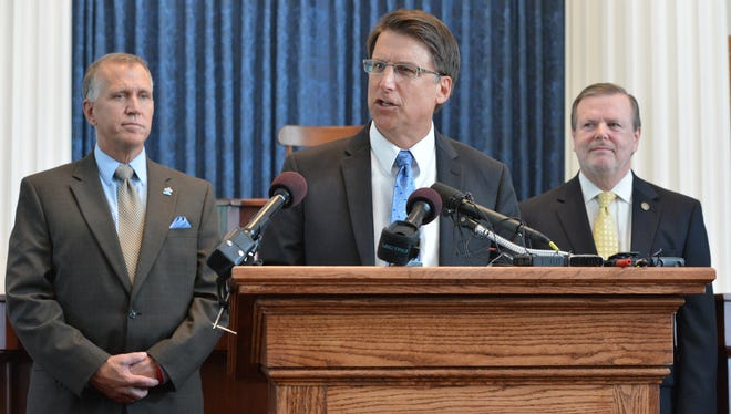From left: Speaker of the House Thom Tillis, Gov. Pat McCrory, and President Pro Tempore of the Senate Phil Berger at a news conference on, July 15.