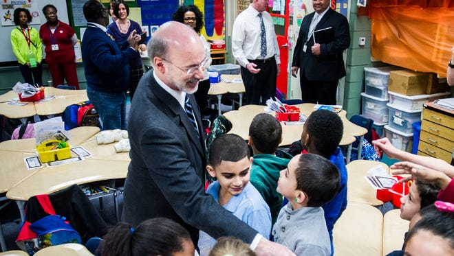 In this file photo, Gov. Tom Wolf shakes hands with students in teacher Maria Wood's second-grade class at Alexander D. Goode School in the York City School District.
