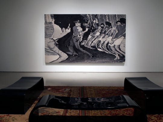 """Noel Anderson's """"die Leitung,"""" 2016-2017, is a distressed Jacquard tapestry. The title comes from a German phrase that can mean """"the administration"""" or """"the line-up"""". The piece is part of Anderson's """"Blak Origin Moment,"""" now showing at the Contemporary Arts Center."""