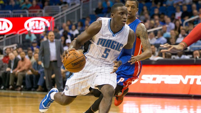 Apr 6, 2016; Orlando, FL, USA; Orlando Magic guard Victor Oladipo (5) drives to the net in front of Detroit Pistons guard Kentavious Caldwell-Pope (right) during the first quarter of a basketball game at Amway Center. Mandatory Credit: Reinhold Matay-USA TODAY Sports