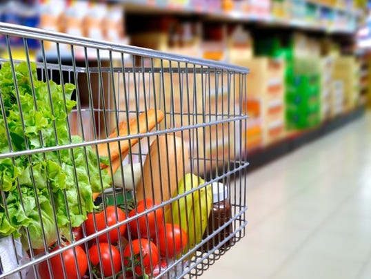cart-in-supermarket-blurred-from-side_large.jpg