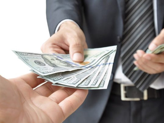 hands-giving-receiving-money_large.jpg
